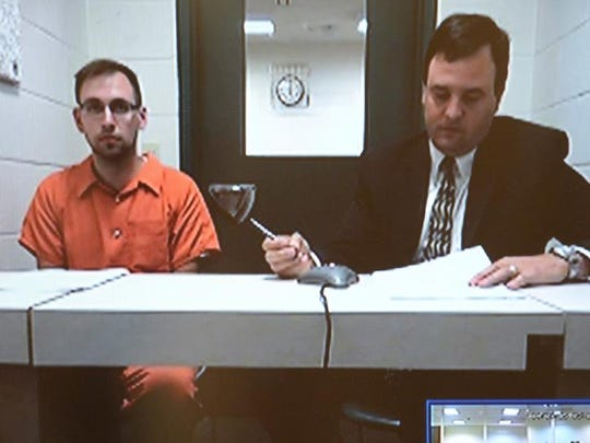 Christopher L. Wieber, left, appears in Brown County Court via video on Monday afternoon.