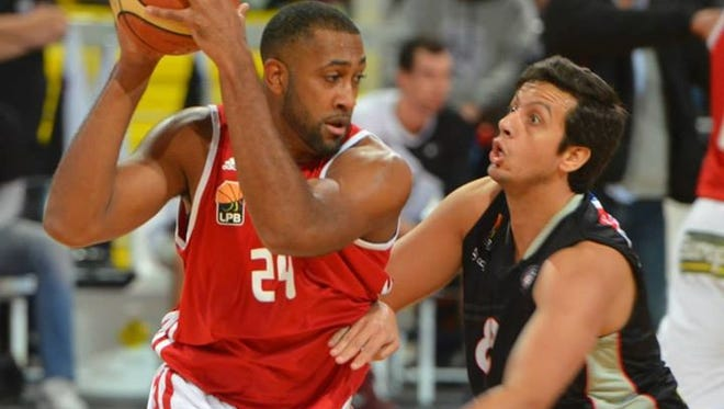 Owen alum David Weaver, left, played his most recent season of professional basketball in Portugal.
