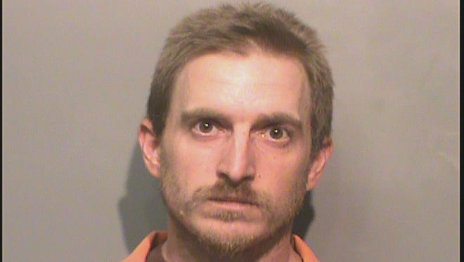 Kenneth Ray Collins, 33, was charged with intimidation with a dangerous weapon.