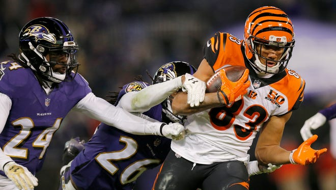 Cincinnati Bengals wide receiver Tyler Boyd (83) breaks a tackle from Baltimore Ravens cornerback Maurice Canady (26) on his way to the end zone for the game winning touchdown in the fourth quarter of the NFL Week 17 game between the Baltimore Ravens and the Cincinnati Bengals at M&T Bank Stadium in Baltimore on Sunday, Dec. 31, 2017. The Bengals won 31-27 in the regular season finale.