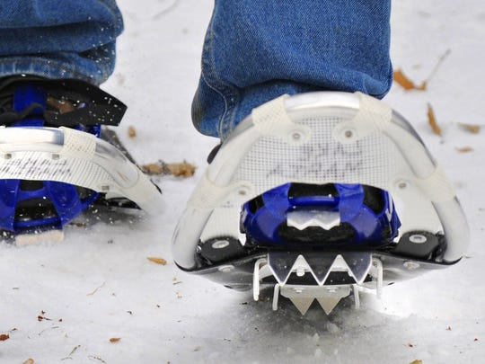 A snowshoer tromps down a packed trail in 2013 at Lake Maria State Park, which rents out snowshoes.