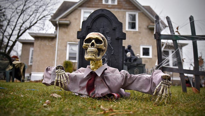 Several Halloween decorations are ready for trick-or-treaters in the yard of Scott and Charlene Ridlon of Waite Park.