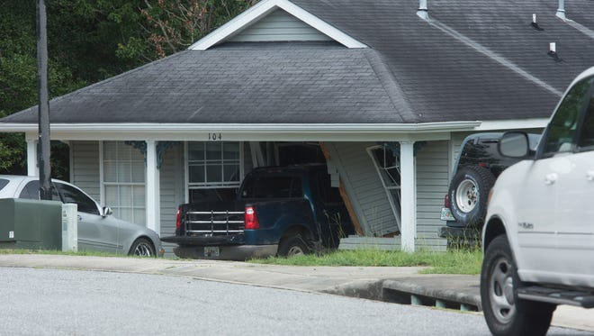 Officers investigate a car crash in the 100 block of Wildflower Lane in Pensacola.