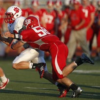 Dixie Heights High School's Colson Machlitt, 58 records a sack while playing in a high school game.