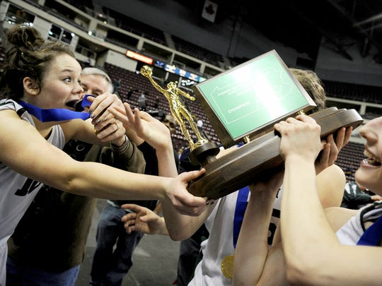 York Catholic players celebrate after beat Delone Catholic, 56-38, to win the District 3 Class AA title Thursday in Hershey. (Daily Record/Sunday News -- Chris Dunn)