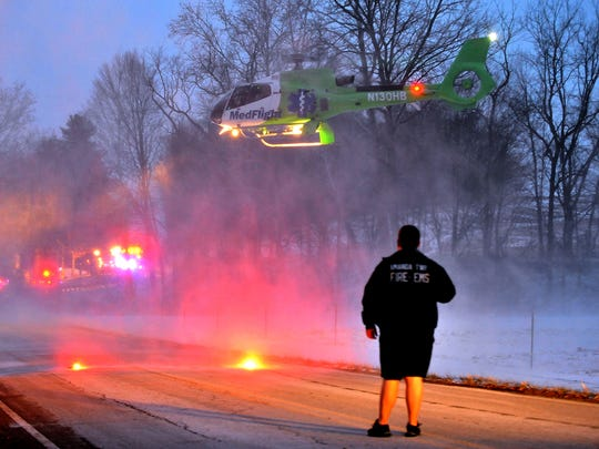 A cloud of snow is kicked up into the air as a MedFlight helicopter lands Jan. 8, 2014, on Clearport Road SW in Madison Township. The helicopter was called to transport Dilon Uhl, the passenger in a single vehicle crash, to Ohio State University Medical Center in Columbus. Uhl later died of his injuries in the crash.