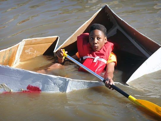 Matthew Turner realizes his cardboard boat wasn't very