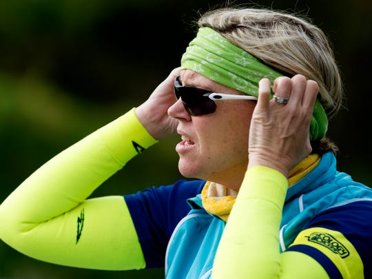 Kella Gerdeman, of Knoxville, puts on sunglasses and neon colors to be more visible on the road during a group bike ride in Maryville, Tennessee on Tuesday, November 14, 2017. Knoxville Regional Transportation Planning Organization created a map of all walker/biker accidents with cars and found that Alcoa has the most per capita.