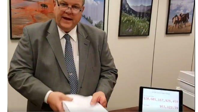 Sen. John Tester with the tax bill