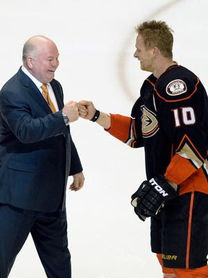 Bruce Boudreau and Game 5 hero Corey Perry bump fists after the Ducks' overtime win against the Flames.