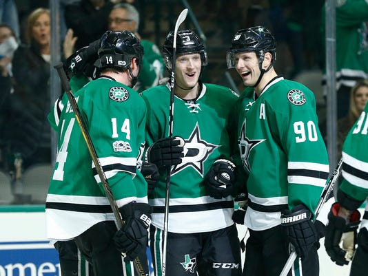 Dallas Stars defenseman John Klingberg, middle, celebrates his goal with center Jason Spezza (90) and left wing Jamie Benn (14) during the first period against the Winnipeg Jets in an NHL hockey game, Thursday, Feb. 2, 2017, in Dallas. (AP Photo/Jim Cowsert)