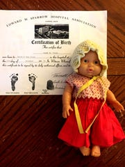 A copy of the birth certificate of Kasey Tuffy Hadd who was born as a preemie on Christmas Eve 1979 weighing in at 15 oz at Sparrow Hospital in Lansing, Michigan.  The baby doll that is 12 inches long is the exact size she was when she was born very early. Even the clothes that the doll is wearing were hand made for her to wear during her many weeks in NICU at the hospital. Eric Seals/Detroit Free Press