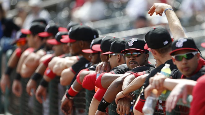 Chris Nelson (third from right,)joins teammates on the rail during their exhibition game against the Cleveland Indians at Goodyear Ballpark on February 26.