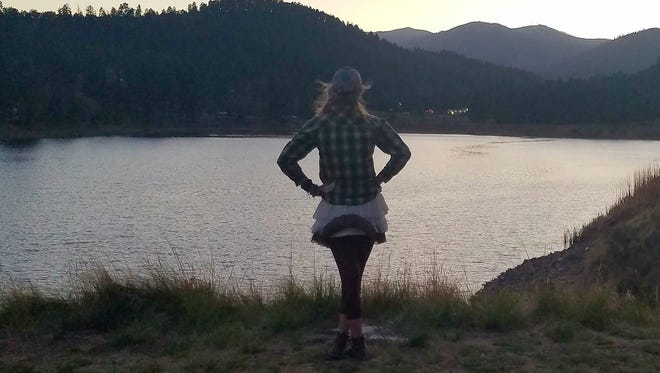 Anna Dozier admires the view of the mountains at Alto Lake during an evening hike.
