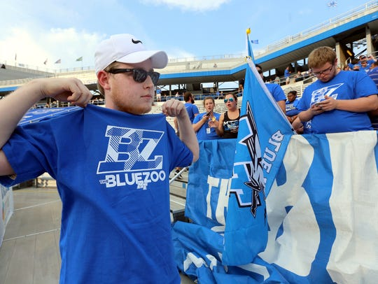 Aaron Grisham, sports his Blue Zoo shirt as he tries