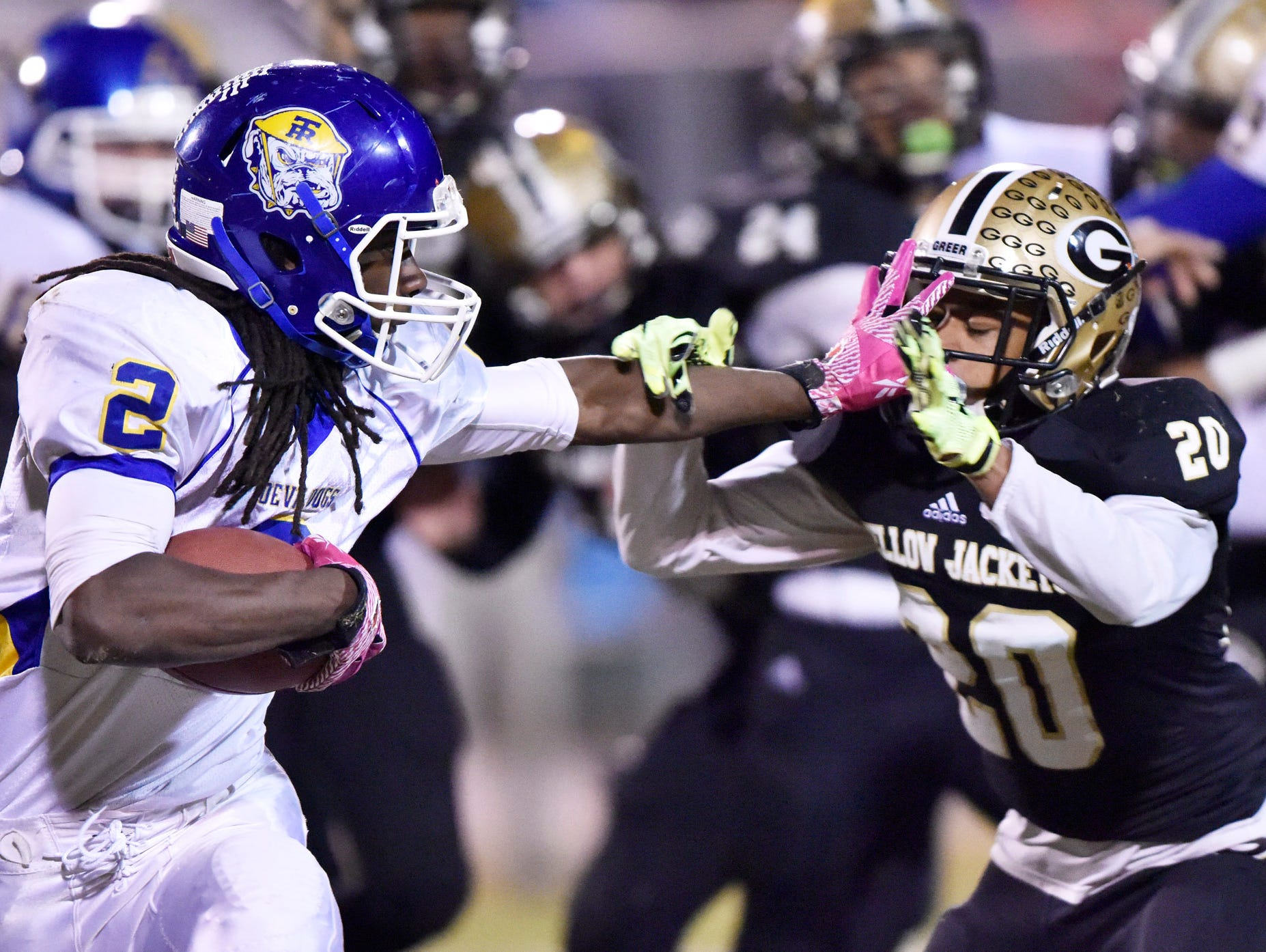 Travelers Rest's Xaiver Terry (2) fends off Greer's D.J. Sitton (20).