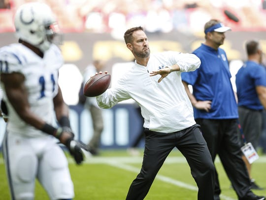 Indianapolis Colts quarterbacks coach Brian Schottenheimer throws pass during warmups before an NFL International Series game against the Jacksonville Jaguars at Wembley Stadium in London on Oct. 2, 2016.