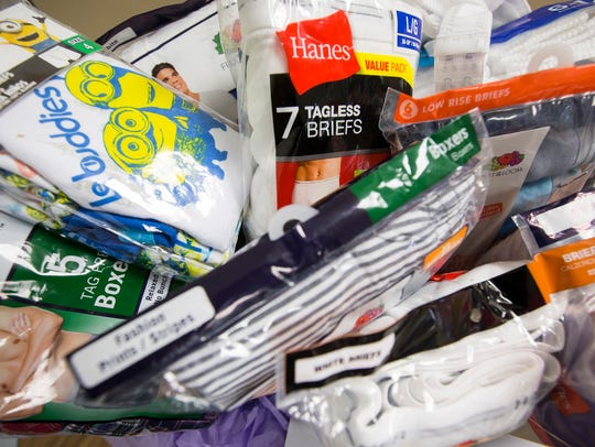 Packages of donated underwear sit in a basket in the offices at the Sunday Breakfast Mission in Wilmington in this file photo.