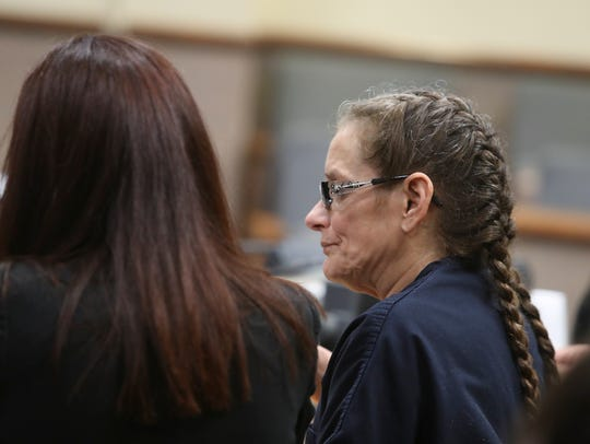 Virginia Anderson speaks with her legal counsel Wednesday