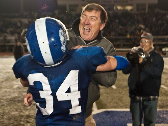 Harper Creek football coach Ed Greenman celebrates winning a regional title before the Beavers would go on to fall to Orchard Lake St. Mary's in the Division 3 state semifinals, 28-7.