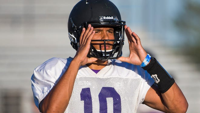 North Canyon High football WR Solomon Enis gets ready for a drill during practice in Phoenix, Ariz. Aug. 7, 2017.