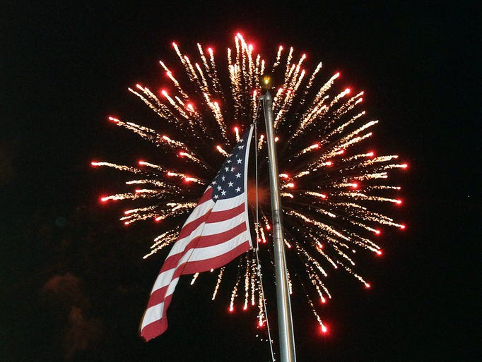 Thousands of people enjoy the festivities during the annual Town of Southeast fireworks display at the Highland Shopping Center off Route 312 in Southeast July 4, 2014.