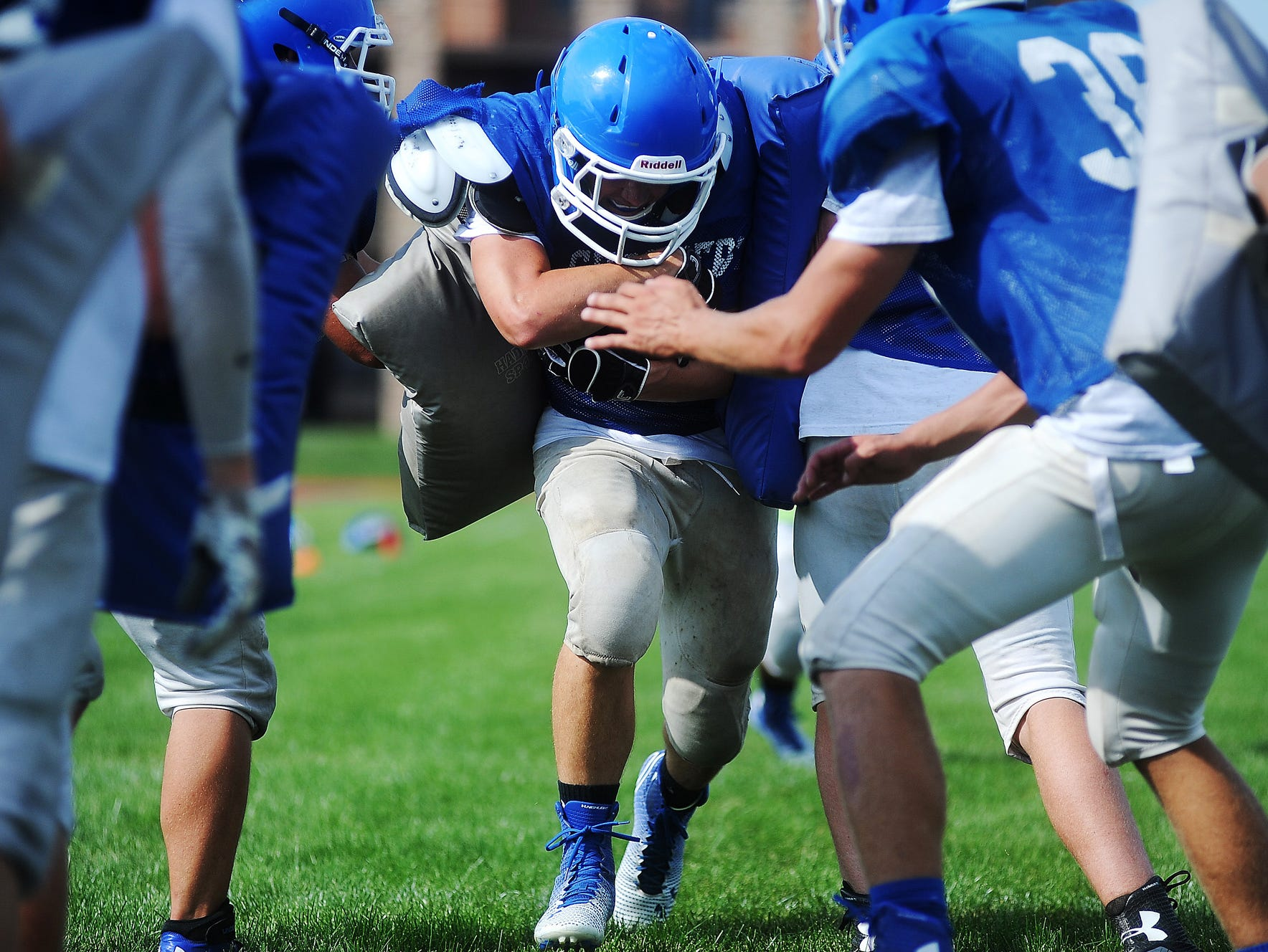 Sioux Falls Christian's Keegan Van Egdom carries the ball as part of a drill during a practice on Thursday, Aug. 21, 2014, at Bob Young Field in Sioux Falls, S.D.