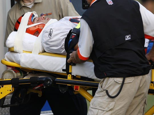 Utecht is loaded into an ambulance after a hit  by Darryl Blackstock left him motionless on the turf.