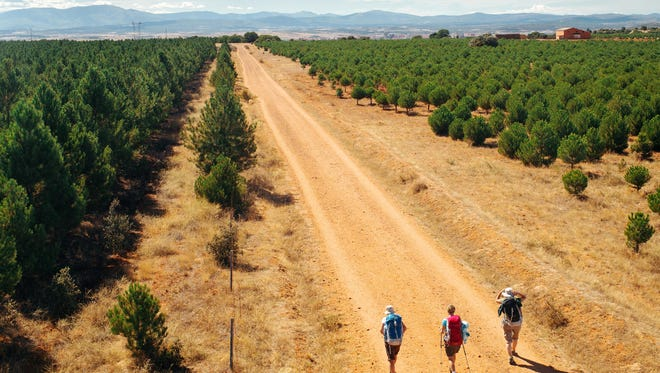 Pilgrims walk The Way of Saint James in Astorga, Spain.