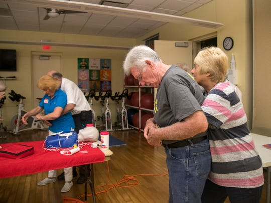 Participants in Stan BartonÕs CPR class learn the Heimlich maneuver on Tuesday, November 29, 2017, in south Fort Myers.