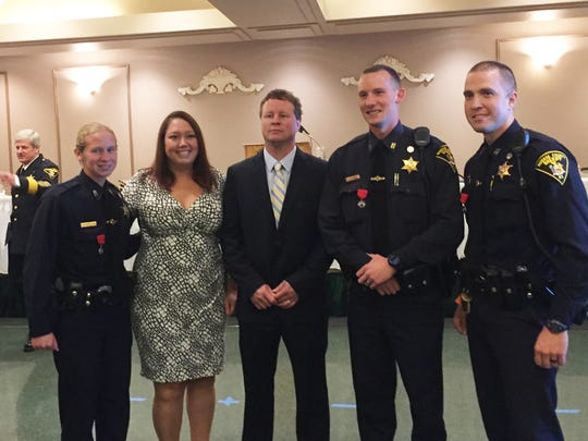 Aimee and Kevin Flannery flanked by Monroe County sheriff's deputies Erin Johnstone, Scott Jolly and James Shaw after the trio of deputies received a life saving award.