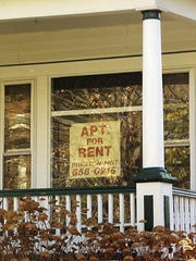 A sign advertises an apartment for rent on Brookes Avenue in Burlington.