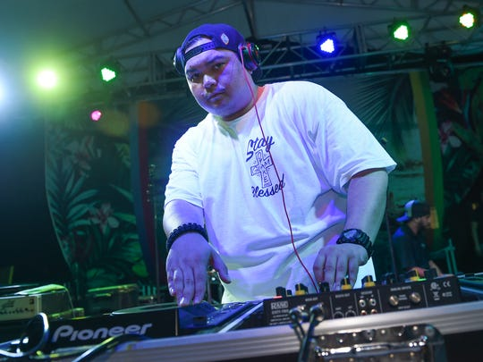 DJ Sylnt performs during a set at the Guam Summer Beach Fest in Tumon on Aug. 13.