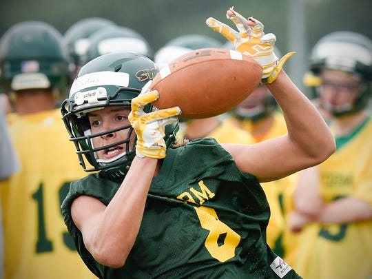 Sauk Rapids receiver Ben DeMars catches a pass on a