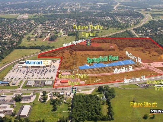 This aerial view of the Springfield Plaza development shows where current and future stores could be located. The red shaded area shows the Plaza land, which will be in two special taxing districts.