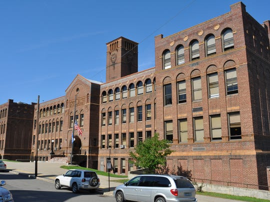 A Watertown, N.Y., developer who bought the former Corning Free middle school will hold a groundbreaking today as renovation gets underway to convert the building to upscale apartments.