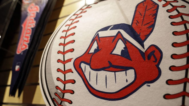 A baseball with the Indians' polarizing mascot, Chief Wahoo, awaits a buyer at the team shop. The logo is no longer on the players' jersey sleeves and caps but is still on lots of merchandise.