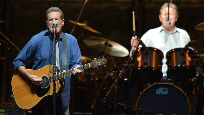 Glenn Frey, left, and Don Henley of The Eagles perform on the 'History of the Eagles' tour at the Forum on Jan. 15, 2014 in Los Angeles.