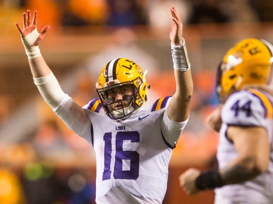 LSU quarterback Danny Etling (16) celebrates the win during a game between Tennessee and LSU at Neyland Stadium in Knoxville, Tenn., on Saturday, Nov. 18, 2017.