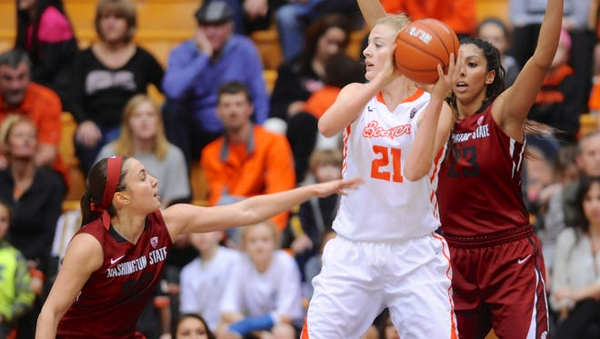 Washington State's Pinelopi Pavlopoulou, left, and Shalie Dheensaw (23) defend Oregon State's Marie Gulich (21) during the first half of an NCAA college basketball game in Corvallis.