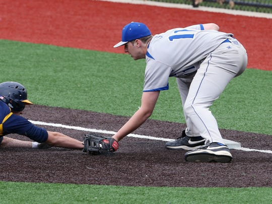 Sayreville's Jayson DeMild tags out Colonia's Mike