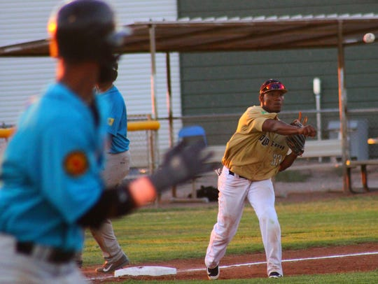 White Sands third baseman Christopher Luciano throws
