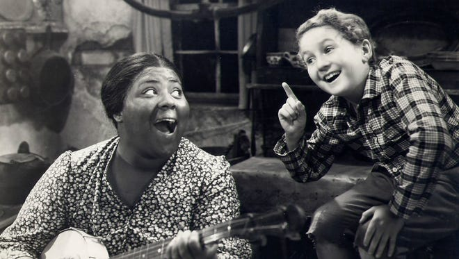 "Louise Beavers with Bobby Breen in 1936's ""Rainbow on the River."""