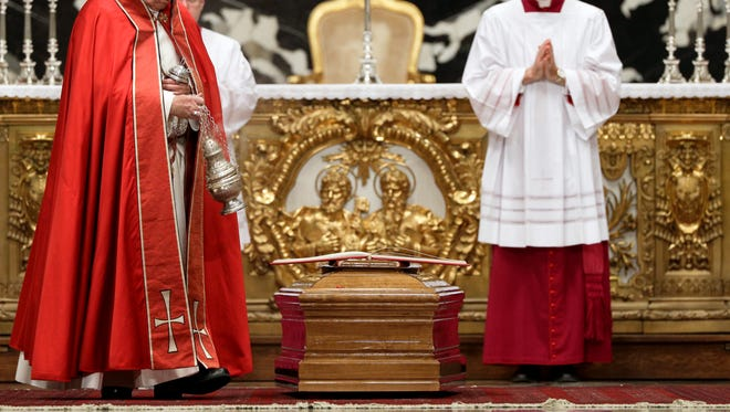 Pope Francis incenses the coffin of late Cardinal Bernard Law
