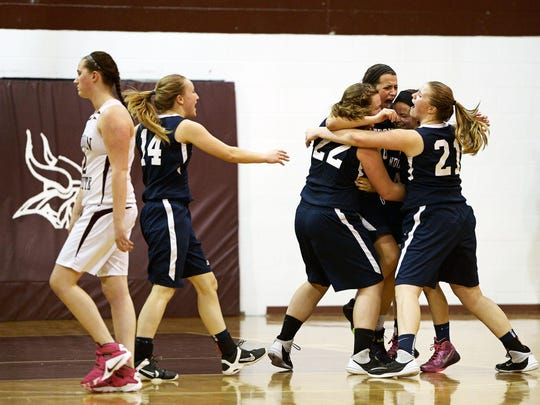 Randolph players celebrate their upset over third-seeded Lyndon Institute in a Division II high school girls basketball quarterfinal in Lyndon Center on Friday.