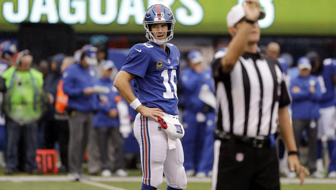 New York Giants quarterback Eli Manning (10) reacts after a call during the second half of an NFL football game against the Jacksonville Jaguars, Sunday, Sept. 9, 2018, in East Rutherford, N.J. (AP Photo/Seth Wenig)