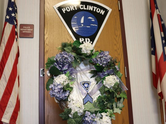 A wreath honoring Sgt. Robert Rigoni, the only Port Clinton Police officer to have fallen in the line of duty, still resides at the department today, along with a plaque preserving his badge.