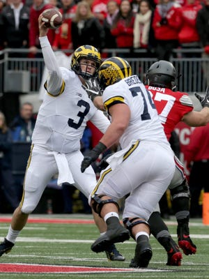 Michigan Wolverines quarterback Wilton Speight throws downfield during the first half against Ohio State at Ohio Stadium on Saturday, Nov. 26, 2016.