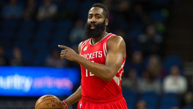 Houston Rockets guard James Harden (13) calls a play during the first quarter against the Minnesota Timberwolves at Target Center.