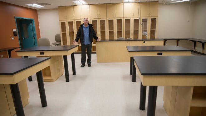 Chris Harrelson, physical plant senior director at San Juan College, shows off one of the school's new classroom on Wednesday.